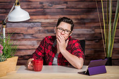 Worried Lesbian Worker Looking at Tablet Stock Photo