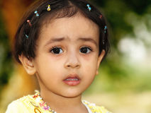 Worried little girl. A cute anxious/worried Indian girl Royalty Free Stock Image