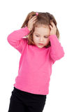 Worried little girl in pink Stock Photography