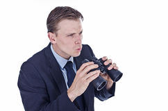 Worried looking businessman holding binocular Stock Photos