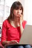 Worried Looking Woman Using Laptop Stock Photography