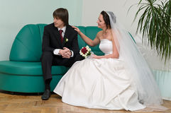 Worried looking young newlywed couple stock image