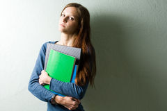Worried looking young student girl. Stock Photo