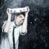 Worried Male Worker Running In The Pouring Rain Royalty Free Stock Photography