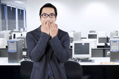 Worried male working in office Royalty Free Stock Photo