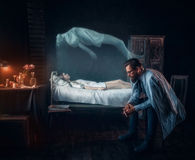 Worried man against dead woman, soul left body Royalty Free Stock Photography