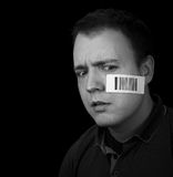 Worried man with barcode. Label on face royalty free stock images