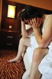 Worried man in bedroom Stock Image
