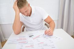 Worried Man Calculating Bills Royalty Free Stock Images