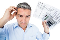 Worried man calculating tax Royalty Free Stock Image