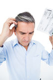Worried man calculating tax Stock Images