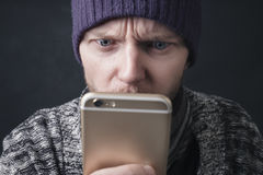 Worried man checking his phone Stock Photo