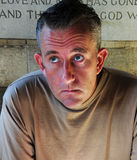 Worried man in church. Shot of a worried scared man in church royalty free stock image