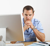 Worried Man at Desk and Computer Paying Bills Stock Image