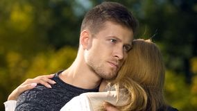 Worried man embracing woman, supporting after loss of close person, care royalty free stock images