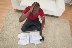 Worried Man With Financial Documents Royalty Free Stock Images