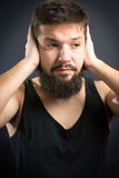 Worried man with hands on face stock photo