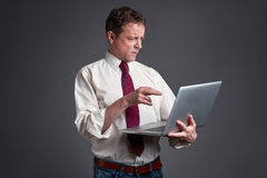 Worried Man with a laptop Stock Photo