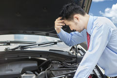 Worried man look at broken machine car Royalty Free Stock Images