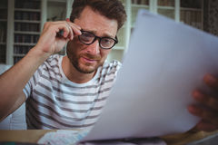 Worried man looking at his bills Royalty Free Stock Images
