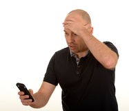 Worried man looking at mobile Stock Photography