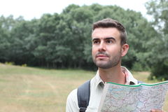 Worried man lost hiking confused looking at map.  Stock Image