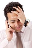 Worried man on the phone Royalty Free Stock Image