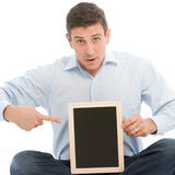 Worried man pointing to black board Stock Photo