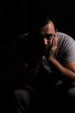 Worried man. Portrait on black background Royalty Free Stock Image