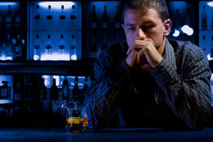 Worried man sitting at bar Stock Photo