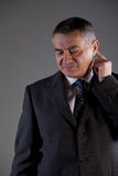 Worried man in suit Royalty Free Stock Images
