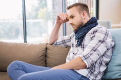 Worried man thinking on the couch Stock Photos