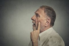Worried man thinking looking up Royalty Free Stock Images