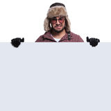 Worried  man in winter clothes is holding board Royalty Free Stock Photo