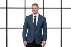 Worried mature businessman in suit. Stock Photos