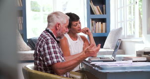 Worried Mature Couple In Home Office Looking At Paperwork stock footage