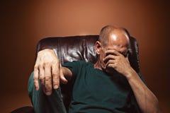 Worried mature man sitting at studio Stock Photos