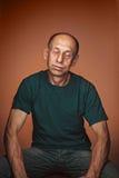 Worried mature man sitting at studio Stock Image