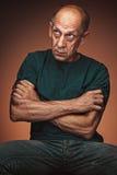 Worried mature man sitting at studio Royalty Free Stock Photo