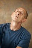 Worried mature man sitting at studio Royalty Free Stock Images