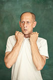 Worried mature man standing at studio Royalty Free Stock Images