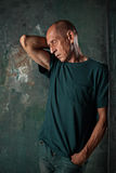 Worried mature man standing at studio Stock Photo