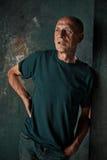 Worried mature man standing at studio Stock Images