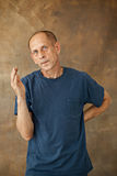 Worried mature man standing at studio Royalty Free Stock Photography