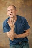 Worried mature man standing at studio Royalty Free Stock Photo