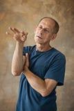 Worried mature man standing at studio Royalty Free Stock Image