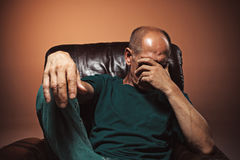 Worried mature man touching his head. Stock Image