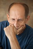 Worried mature man touching his head. Royalty Free Stock Photo