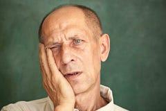 Worried mature man touching his head. Stock Photo