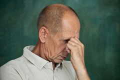 Worried mature man touching his head. Royalty Free Stock Photos